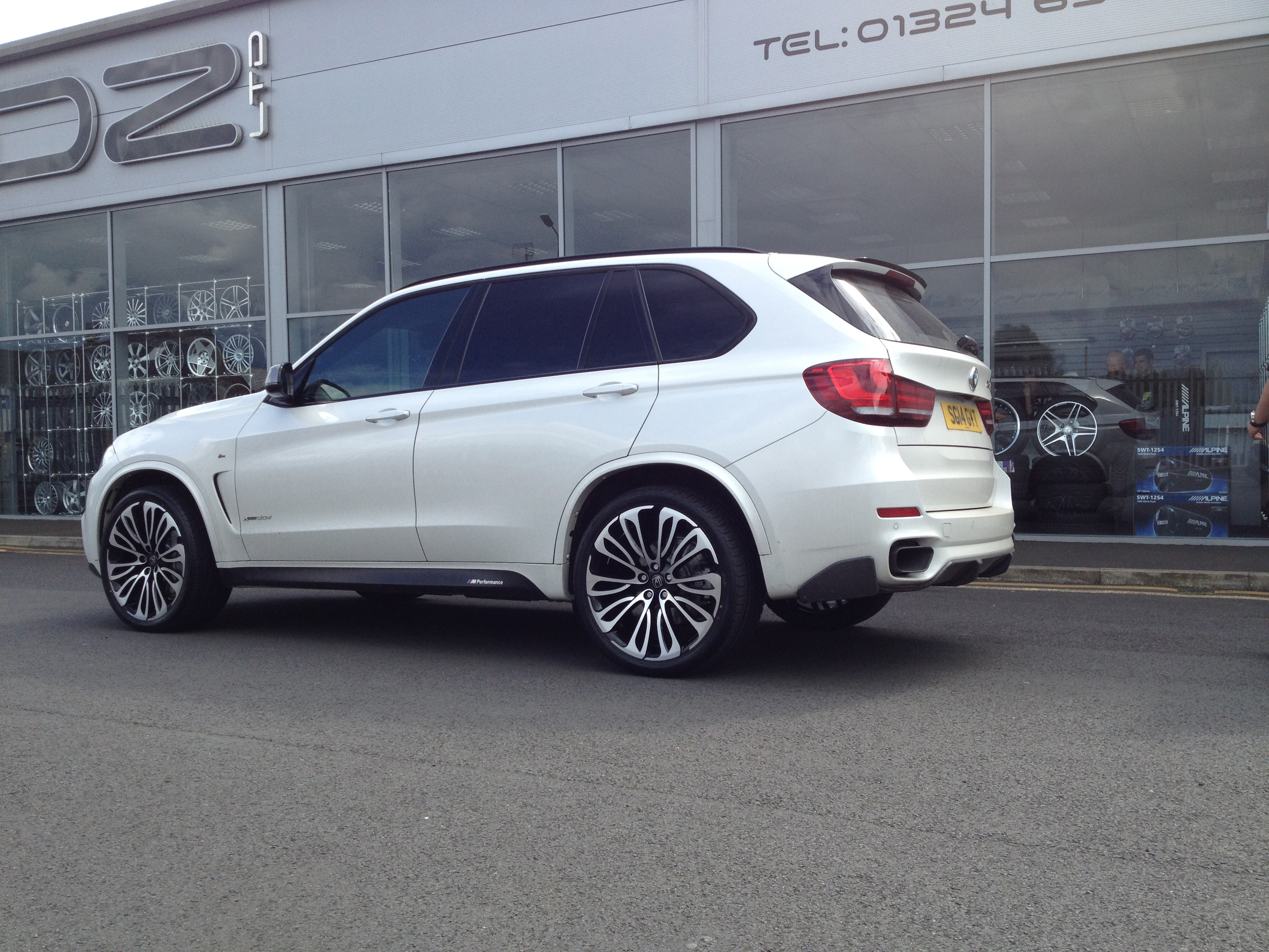 White BMW X6 on HAWKE Halcyon wheels in Black Polished colour finish